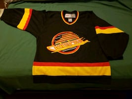 CCM Authentic Canucks skate jersey adult small