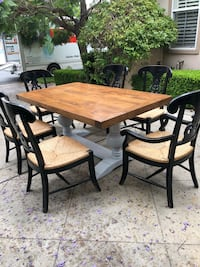 rectangular brown wooden table with four chairs dining set Newport Beach, 92657