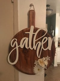 Round paddle board wall decor with Gather in metal and beautiful Artificial flowers Buena Park, 90620