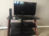 black flat screen TV with black wooden TV stand Denver, 80211