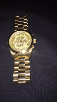 round gold-colored chronograph watch with link bracelet Toronto, M8W 1B2