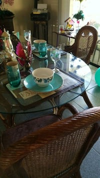 round glass top table with four chairs dining set Apopka, 32703