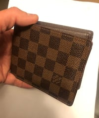 Louis vuitton wallet authentic  New Westminster, V3M 6X3