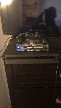 black Sony PS4 console with controller and game case Germantown, 20874