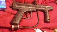 Two paintball guns with accessories.  Adams, 53910