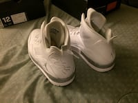 Pair of white nike low-top sneakers Los Angeles