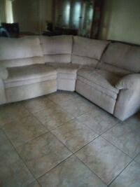 3pc tanish sectional with 2 built in recliner. 829 mi