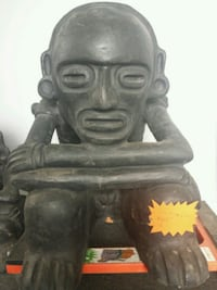 Handcrafted clay thinking man from Dominica  Guelph, N1H 1E8