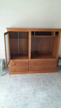 brown wooden hutch with cabinet