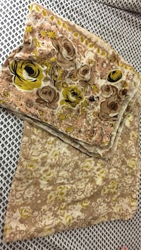 Brown and green floral textile