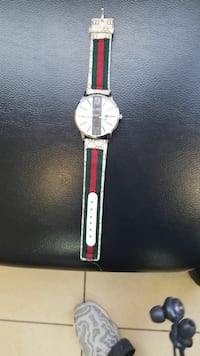round silver-colored analog watch with red leather strap Guelph, N1E 0B3