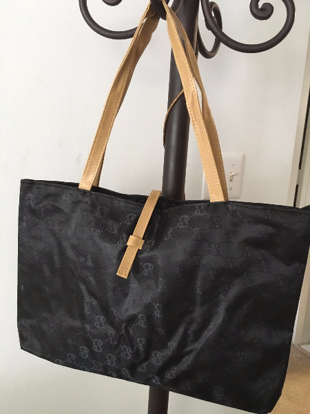 beige and black leather tote bag
