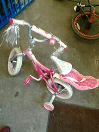 toddler's pink and white bicycle with training wheels Lincoln Park, 48146