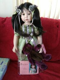 Pocelain doll from Paradise Galleries including c