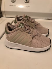 pair of gray Adidas low top sneakers
