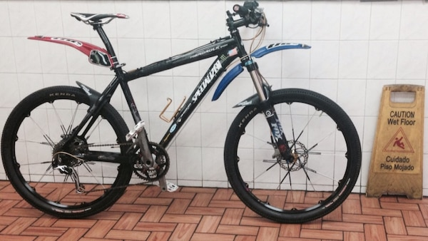 Black and gold specialized hard rock hardtail mountain bike