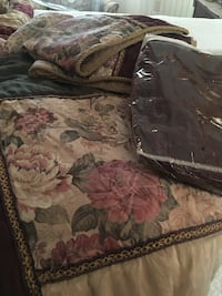 Gray, green, and red floral print. Comforter, pillow shams and bed skirt Bladenboro, 28320