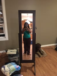 Full-length mirror with jewelry storage