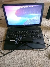 black laptop computer with charger Hyattsville, 20784