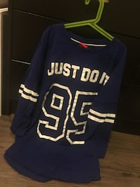 blue and white Just Do It-printed long-sleeved shirt Calgary, T3N
