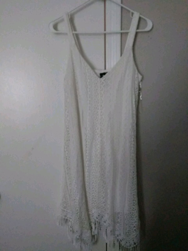 3df3e2c36d6aa Used women s white spaghetti strap top for sale in Lewisville - letgo