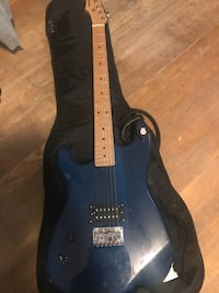 Electric Guitar with Amplifier and Case