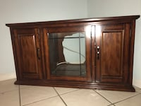Tv hutch stand. Brown wooden sideboard