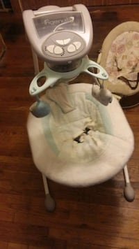 baby's white and gray cradle and swing 866 mi