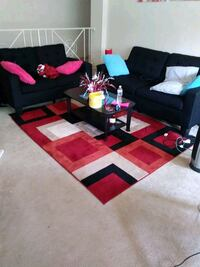 Red and black living room set with a coffee table  New Carrollton