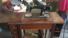 Black and brown treadle sewing machine brand singer