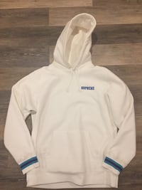 white and blue Supreme pullover hoodie