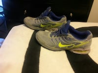 pair of gray-and-green Nike athletic shoes Spanaway, 98387
