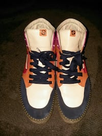 pair of white blue and orange sneakers