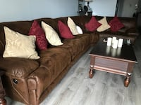 Beautiful brown sectional with 3 power recliners; throw pillows included.