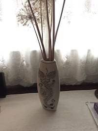 Unglazed white clay vase Chicago