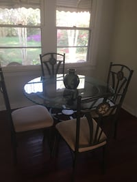 black metal base glass top table with chairs