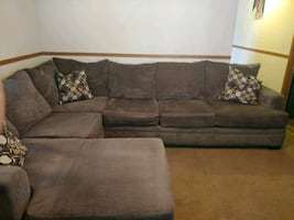 "Sectional ""L"" Shaped Sofa with Contrasting Pillows."