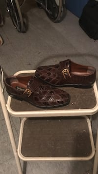 pair of brown leather monk shoes