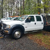 2007 FORD F-550 4X4 CREW CAB DIESEL WITH PLOW AND SPREADER