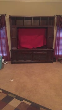 black wooden TV hutch with flat screen television Shreveport, 71107