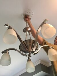 Nickel with frosted light covers uplight chandelier Lakewood, 08701