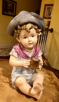 "VINTAGE PIANO BABY BISQUE FIGURINE YOUNG BOY WITH FEATHER IN HAT HOLDING GOLD CUP.  STANDS 9"" HIGH   HAND PAINTED WITH 24K PAINTED GOLD CUP Wood-Ridge, 07075"