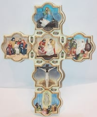 Wall Cross with many 3 dimensional carved pictures Ottawa