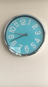 gray and blue round analog wall clock