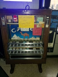 Cigarette machine, vending machine