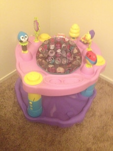 baby's pink and purple activity saucer