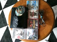 black Sony PS3 super slim console with 7 games Kitchener, N2E 2B4