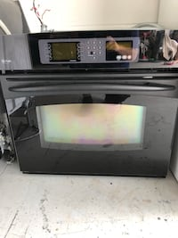 Black and gray induction range oven 796 mi
