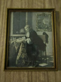 man and woman painting with brown wooden frame London