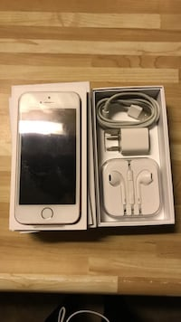 Rose gold iphone se 16 gb with box charger headphones, key sim card, and apple sticker.